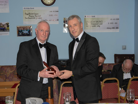 W.Bro. John Gibson on behalf of W.Bro. Neil Ritchie presenting the W.M with a Maul for the Lodge to celebrate its 150th Anniversary.