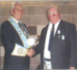 W.Bro. Frank McNeice on 1995 being presented with his 50 Year Jewel by V.Wor. Bro. Stanley McIlroy.