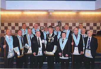W. Bro. Tommy Chambers being presented with his 50 year Jewel by R. Wor. Bro. Bill Dyer accompanying by the Wardens, Officers and Brethren of Abbey Masonic Lodge 180.