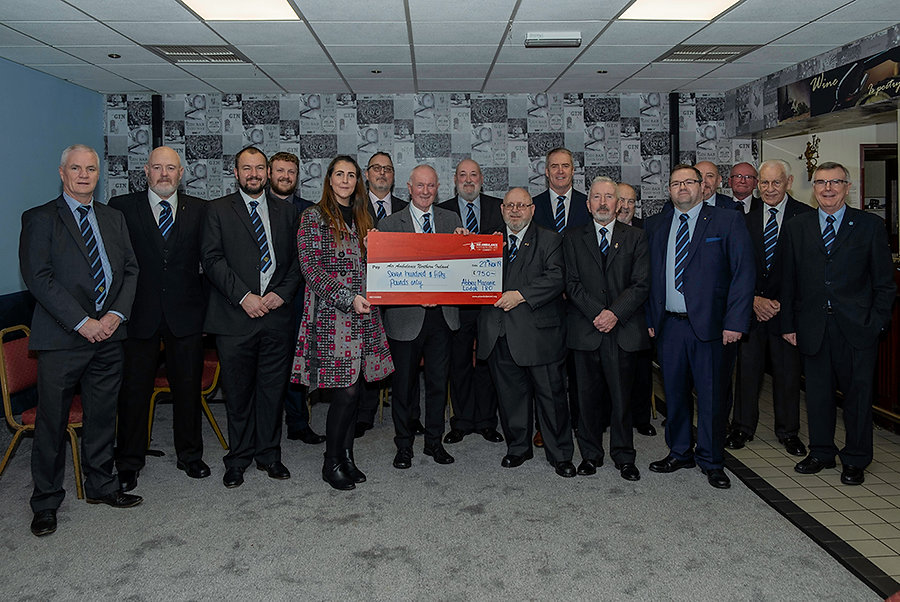 Worshipful Master, W.Bro. Lee Burnside accompanied by Brethren of the Lodge presenting a cheque for £750 to Grace Williams from the Air Ambulance.