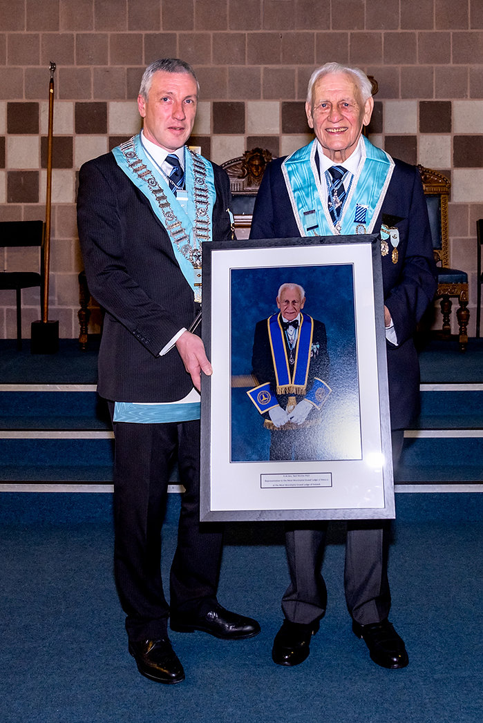 W.Bro. John Gibson who was standing in as Worshipful Master for Abbey 180's current Worshipful Master, W.Bro. Joe Corr, presents R.W.Bro. Neil Ritchie, PGO, Representative to the Most Worshipful Grand Lodge of Mexico at the Most Worshipful Grand Lodge of Ireland. his portrait .  The picture will hang in the Whiteabbey Masonic Centre