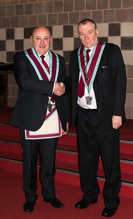 Bro. Freddie Hoy outgoing V.W.M., congratulating the new V.W.M. Stephen Houston.