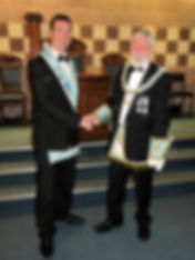 W.M being congratulated By Grand Lodge Steward V.W. Bill McClenghan GS