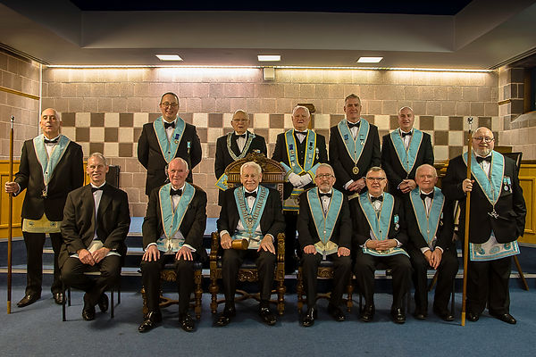 Worshipful Master, Neil Ritchie accompanied by the Officers of Abbey 180 and his son bro. Ian Ritchie.