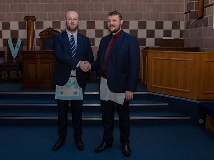 Bro. Andy Moore congratulating his friend  Bro. Jamie Linton after receiving his Entered Apprentice Degree.