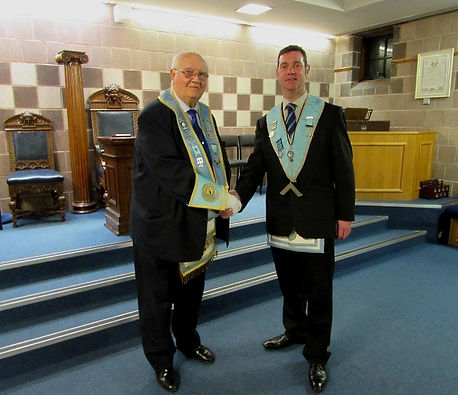 W.M. Stephen Bell welcoming W.B. Bobby Scott to Abbey Masonic Lodge 180 as the Lodges new Inspector