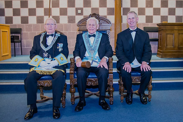 Worshipful Master, Neil Ritchie accompanied by, R.W. Bro. Jim McFarland and his son Bro. Ian Ritchie.