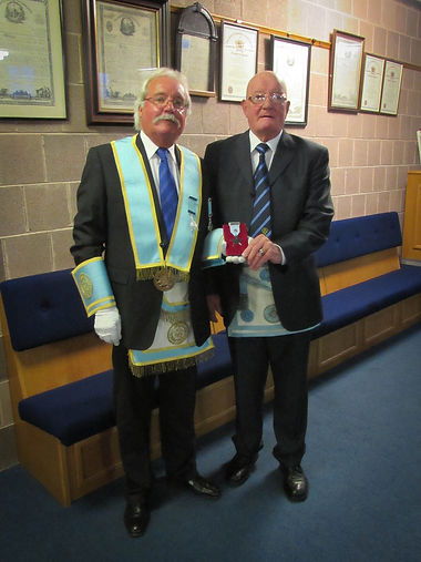 W.B. Brian Morrison who in Open Lodge presented W.B. Richard Wilson with his 50 year jewel.