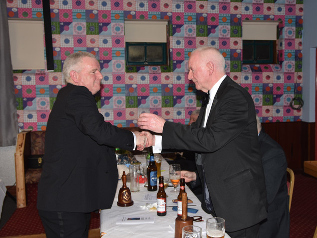 W.B. Richard Burnside presenting the W.M. with a personal Maul.