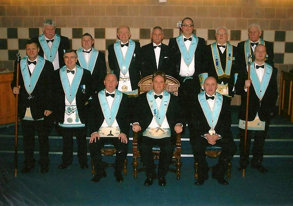 W. Bro. Robert Lenaghan, Abbey Masonic Lodge 180, pictured with his Wardens and Officers after his installation in 2011.