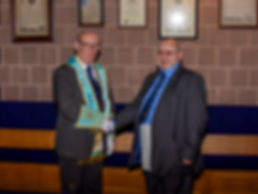 W. Bro. James Megaw Past Provincial Grand Steward  of Down congratulates Bro. Hugh Blair on receiving his F.C. degree.