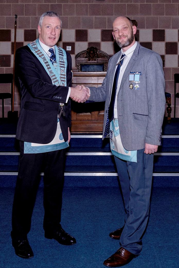W.Bro. John Gibson welcomes his visitor, W.Bro. Dean Reid, Worshipful Master of Bangor Union 746 to Abbey 180