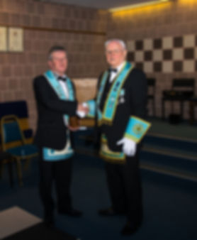 The Installing Officer, V.W.Bro. Bobby Spiers congratulating the new Worshipful Master of
