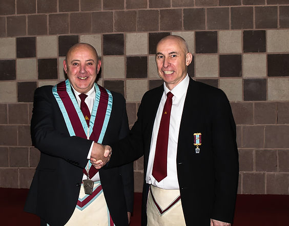 Bro. Simon Lusty, Installing Officer congratulating the new V.W.M. Stephen Houston.