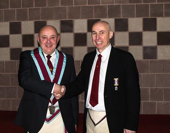 Bro. Simon Lusty, Installing Officer congratulating the new V.W.M. Stephen Houston.