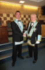 W.M. Stephen Bell being congratulated by V.W. Bro Bobby Spiers who installed him as W.M. for Abbey 180