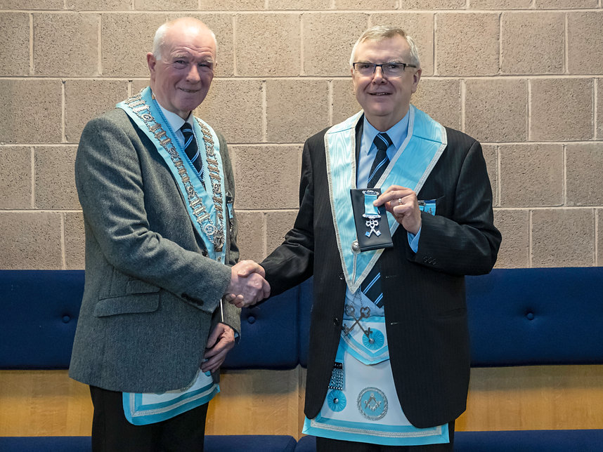 Worshipful Master, W.Bro. Lee Burnside presents W.Bro. Jim Porter with a Treasurers Jewel on his retirement after being the Lodge Treasurer for 11 years