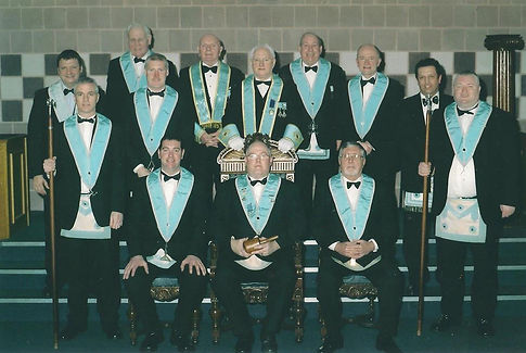 W. Bro. Bill McMurdie, Abbey Masonic Lodge 180, accompanied by his Wardens, Officers and Brethren after his installation in 2004.