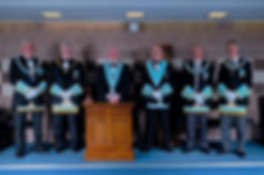 Worshipful Master, W.Bro. Lee Burnside accompanied by the Deputy Grand Master, R.W.Bro. Rodney L. McCurley,  Provincial Grand Master of Antrim, R.W. Bro. J. McLernon,  Provincial Deputy Grand Master of Londonderry and Donegal, R.W.Bro. Kenneth Doherty, Provincial Assistant Grand Master of Londonderry and Donegal, R.W.Bro. Grahame Harper and Director of Ceremonies, W.Bro. Alan Hunter.