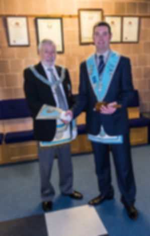 Worshipful Master Stephen Bell welcoming Very Worshipful Bill McClenaghan