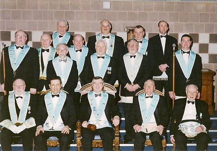 W. Bro. Jim Porter, Abbey Masonic Lodge 180, accompanied by his Wardens, Officers and Brethren after his installation in 2002