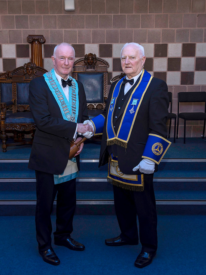 R.Wor. Bro. Bobby Spiers, the Installing Officer and Elected Member to the Grand Lodge of Instruction & also Grand Lodge Representative to the Grand Lodge of Portugal, congratulating W.Bro. Lee Burnside after his Installation.