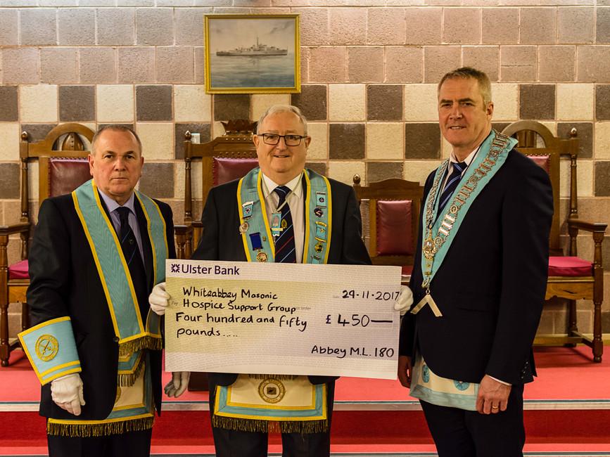 W.M. Eddie Spiers presenting cheque to the Northern Ireland Hospice.