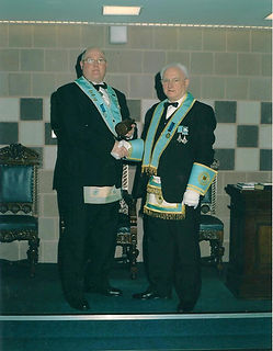 W. Br.o Bill McMurdie, Abbey Masonic Lodge 180, being congratulated by V. Wor. Bro Bobby Spiers after his Installation
