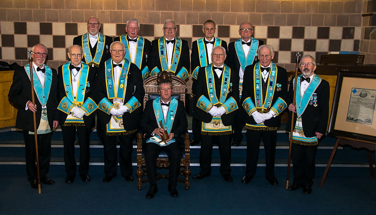 Worshipful Master, Terry Moore accompanied by Provincial Officers after his Installation.