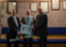 Worshipful Master Lee Burnside being presented with a Worshipful Masters Apron by his Brothers, W.Bro. Richard Burnside and W.Bro. George Burnside.
