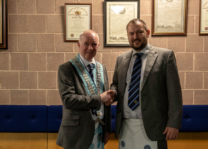 Worshipful Master Lee Burnside congratulates Bro. Gareth Moody after receiving his Fellowcraft degree.