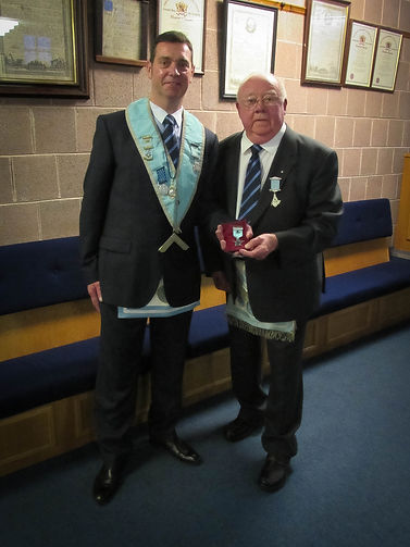 W.M. Stephen Bell who in Open Lodge presented W.B. Frank McNeice with his 60 year jewel.