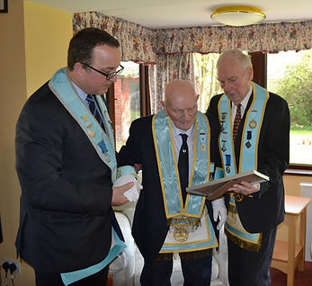 W.M. Ian Eachus, Abbey Masonic Lodge 180, along with R. Wor. Bro. Bill Dyer presents V. Wor. Bro Sidney Vokes with his 50 year jewel.