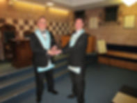 W.Bro. Ian Eachus outgoing W.M. presenting the Masters Lodge jewel to W.Bro. Stephen Bell.