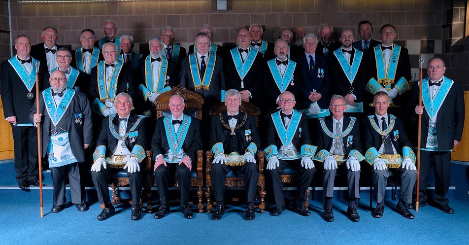 Worshipful Master, W.Bro. Lee Burnside accompanied by the Deputy Grand Master, R.W.Bro. Rodney L. McCurley,  Provincial Grand Master of Antrim, R.W. Bro. J. McLernon,  Provincial Deputy Grand Master of Londonderry and Donegal, R.W.Bro. Kenneth Doherty, Provincial Assistant Grand Master of Londonderry and Donegal, R.W.Bro. Grahame Harper, Wardens, Officers, Brethren of the Lodge and visitors.