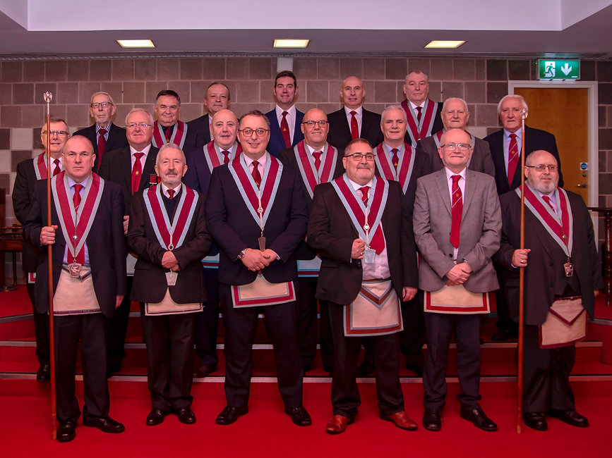 V.W.M. Ian Eachus ccompanied by his Officers, Brethren and visitor.