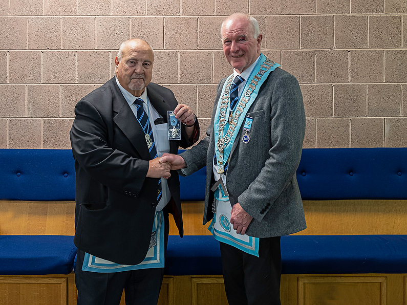 W.Bro. Fred Dyer being congratulated by the Worshipful Master, W.Bro. Lee Burnside on receiving his 50-year Jewel and Certificate.   He joined JD Williamson 283,  Newtownards Road, receiving his E.A. degree on the 19/9/1969, F.C. on 17/10/1969 and M.M on 16/01/1970. He joined Grosvenor 393, Arthur Square, becoming Worshipful Master in 2006 and 2007. When Grosvenor returned its warrant in November 2014, he joined Abbey 180.