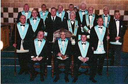 Wor. Bro Gary Spiers, Abbey Masonic Lodge 180, pictured with his Wardens, Officers and Brethren after his installation in 2010