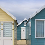 Sinister beach huts. 'Consuming Desires' Radio 4 story by Anita Sullivan. Tailor measures customer.