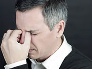 bigstock-Man-With-Migraine-Holds-Bridge-