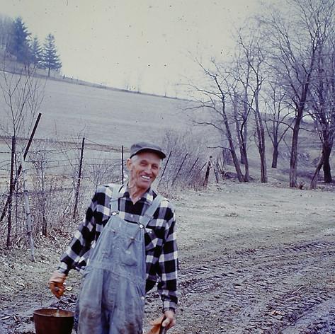 Grandpa with sap buckets.jpg