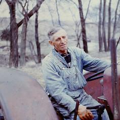 Grandpa on sap collecting tractor.jpg