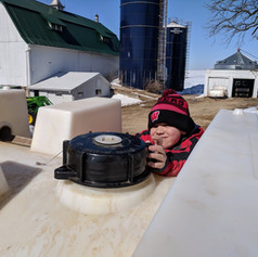 Dylan closing lid on tank.jpg