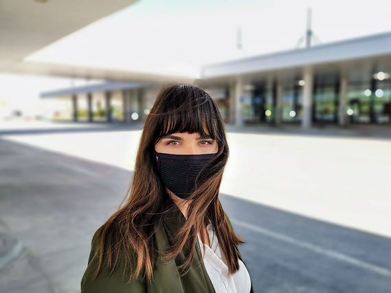young-woman-in-city-wearing-a-mask-covid