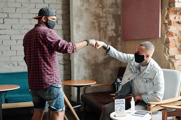 making-fist-bump-with-friend-5X4ZT59.jpg