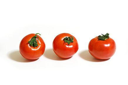 ㈱蓮のホームページトップ画像。フレッシュミニトマトが三つ。