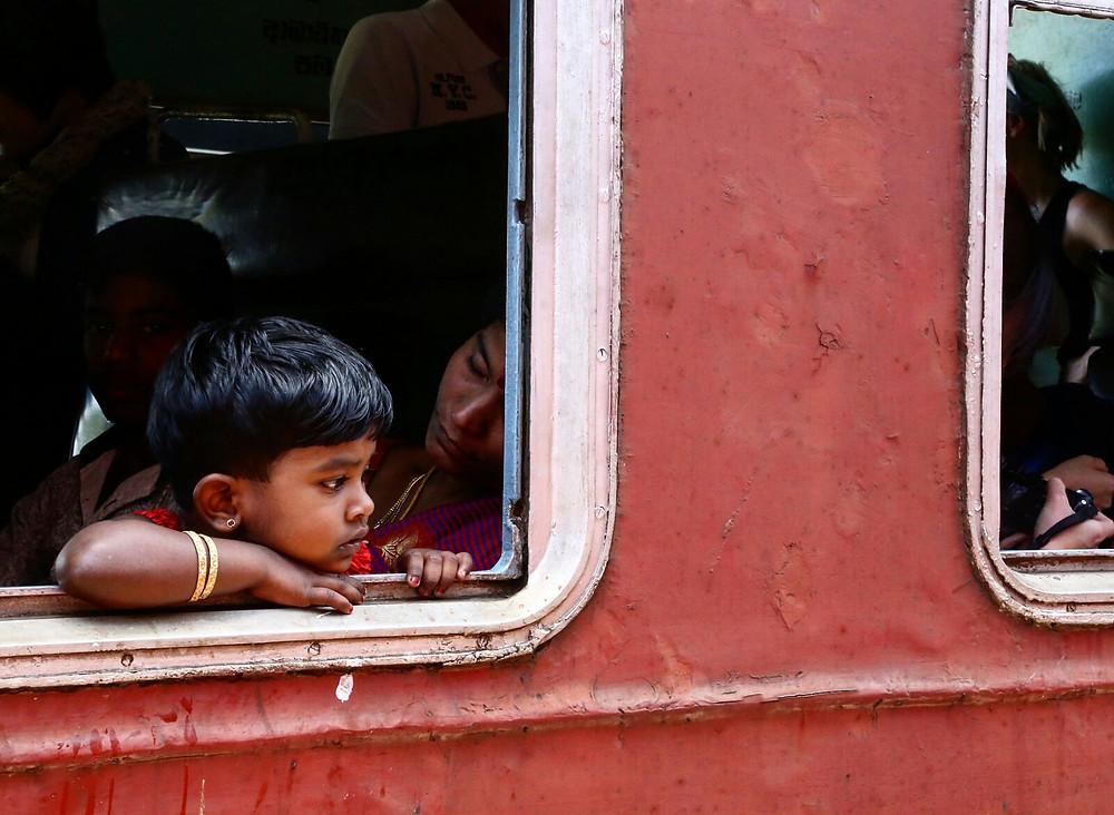 Little girl taking a train ride to Kandy, Srilanka. nrm insurance