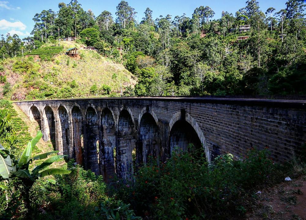 "Nine Arches Bridge. It is also called ""Ahas namaye palama"" (Nine skies bridge) in Sinhala. nrm insurance"