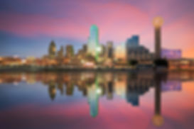 Dallas, Texas cityscape with blue sky at