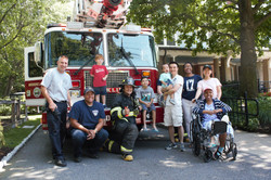 Firefighters and families in front
